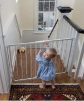 child at baby gate
